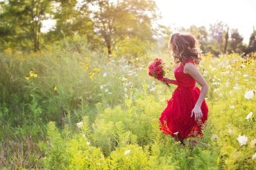 girl in field of flowers